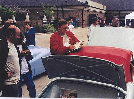 Lou Metalko talks with two other TR2 enthusiasts from TRA, Joe Richard (in red jacket) and John Saunders, now deceased.